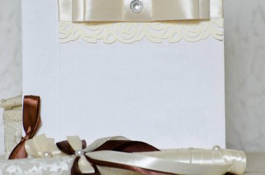 Part of the wedding card with ribbon and lace. White background, space for text