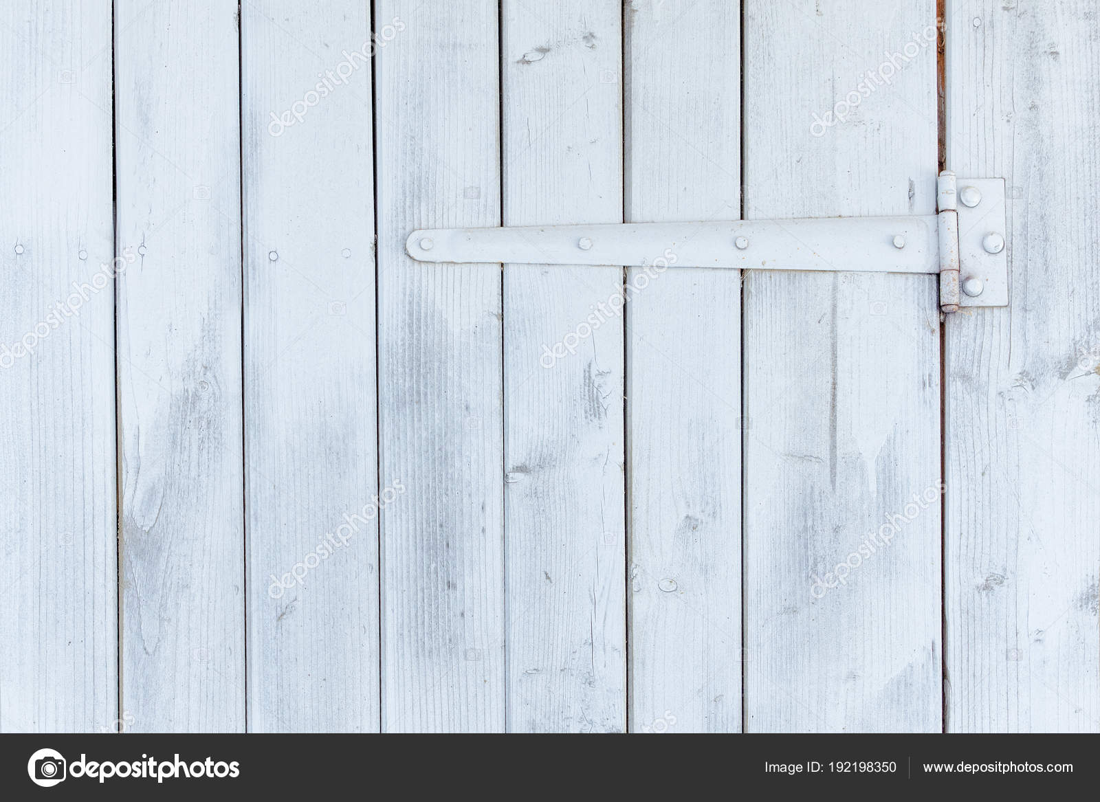 Part Of The White Wooden Door With Hinges Stock Photo