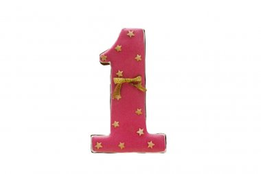 Pink number 1 cookie for the cake. Isolate on white background.