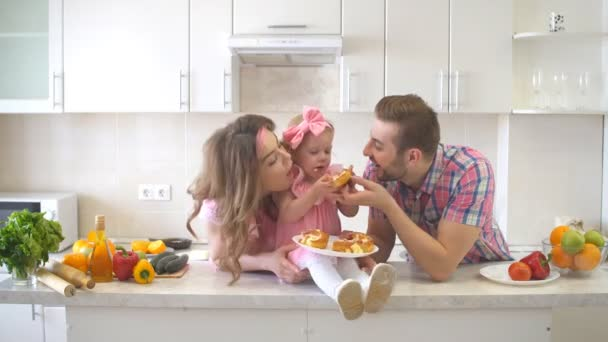 Happy Family Eating Cake in the Kitchen.