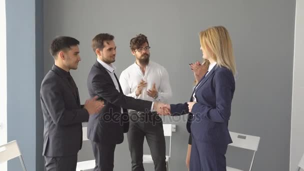Group of young businessman on business meeting. Successful negotiations a completed with a handshake.