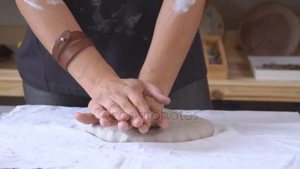 Female Sculptor Is Pugging And Kneading Clay For Creating Pottery