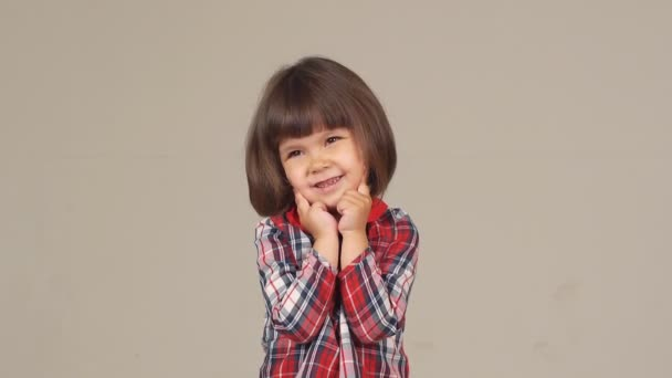 portrait of a cute little girl. beautiful girl posing funny and carefree smiles