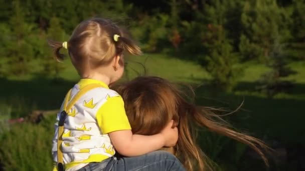 Happy Family Smiling. Beautiful family in summer park enjoying nature. Slow motion