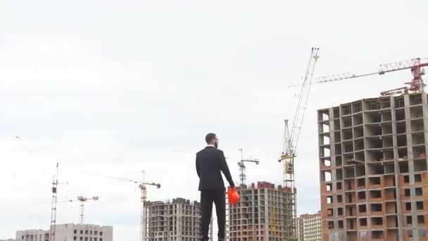Professional people at work, portrait of happy and confident architect with safety helmet in construction site