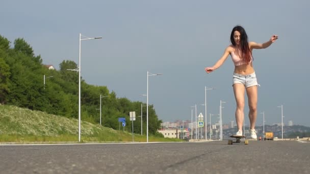 Woman skateboarding at sunrise. Legs on the skateboard, moves to success