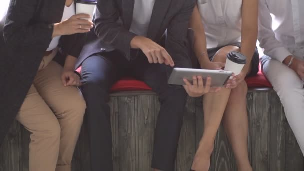 Group of Young Business People using Tablet in Coffee Shop. Slow motion