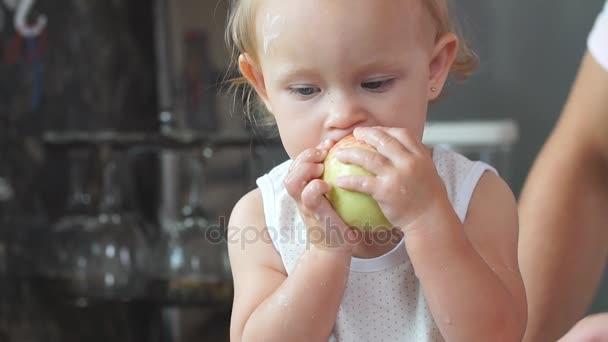 Cute little girl eating apple