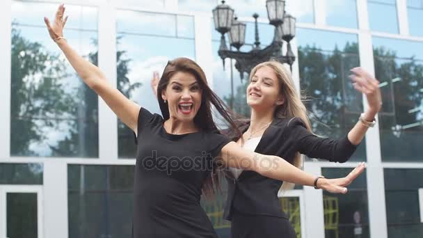 Two business girls feel happy after a successful transaction.