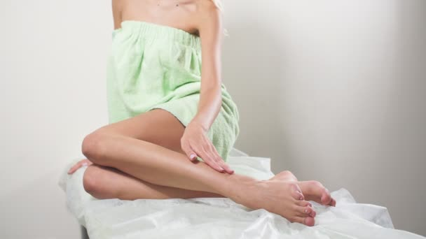 Hair Removal Concept. Womans Hand Touching Sexy Long Legs. Beauty Body Care Concept