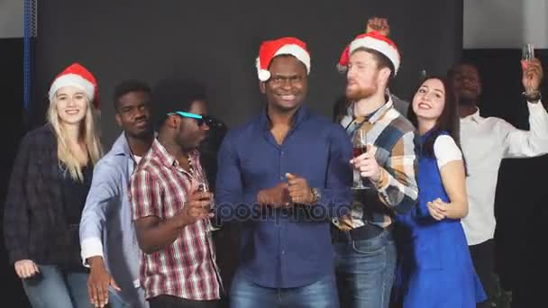 Multi ethnic group friends dancing laughing smiling and having fun at party in studio.