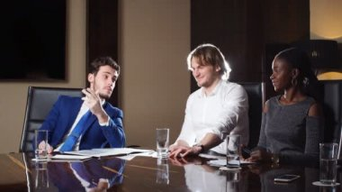 Boss Discussing Figures With His Multi-Ethnic Professional Team.