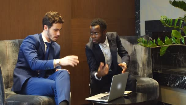 Two Young Businesspeople Having Discussion.
