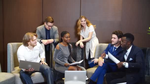 Six Young Businesspeople Having Discussion.