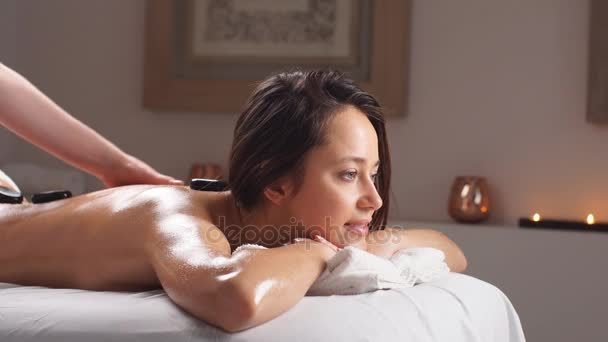 Young Woman Receiving Hot Stone Massage Stone Therapystone Massage Spa Treatments