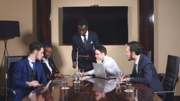 African American Business Man Giving A Presentation To Associates