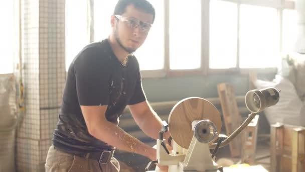 Man Doing Woodwork in Carpentry. Carpenter Work on Wood Plank in Workshop.