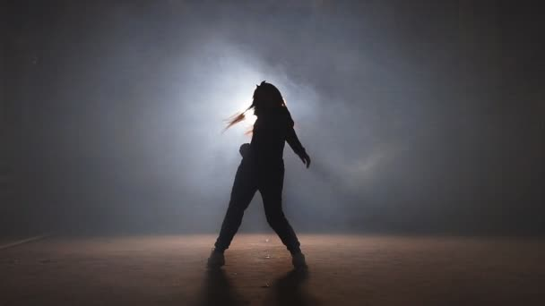 Caucasian girl dancing hip hop.