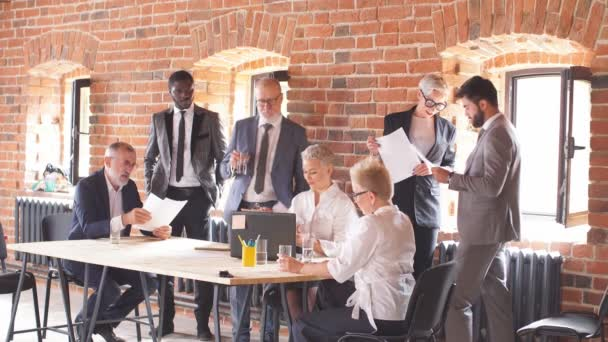 Group of business people brainstorming together in meeting room