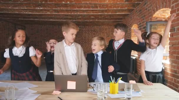 Positive cheerful children rejoicing at successful business