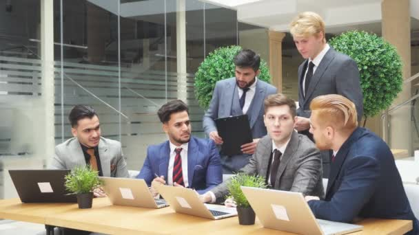 Team of busy young business people in meeting at office