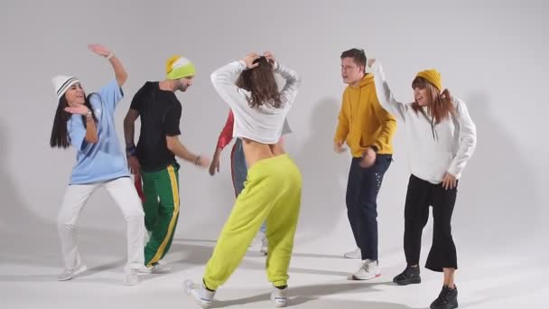 Group of young people dancing with pleasure