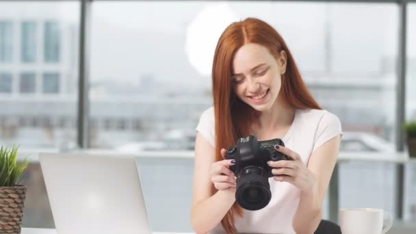 Portrait of happy journalist girl with digital camera in hands