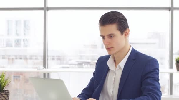 Young businessman working laptop in office