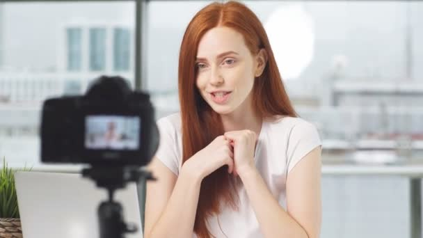 Girl beauty blogger records training video course on digital camera