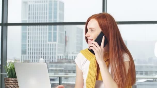 Joyful redhead girl beauty blogger working in office