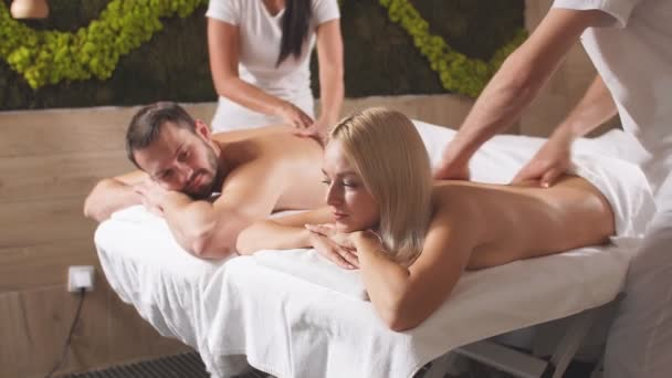 Charming lovely couple spending free time in beauty spa center