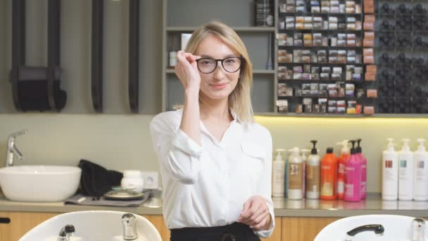 Portrait of smiling consultant in beauty saloon