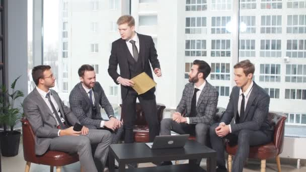 Young manager with business people