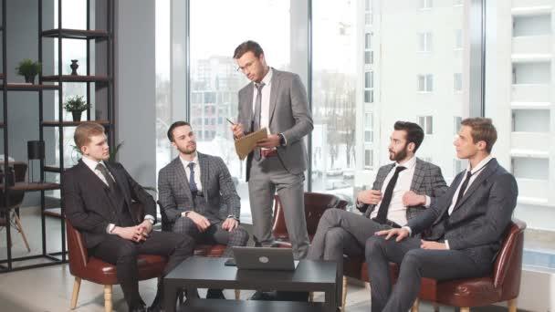 Handsome guys in tux coworking