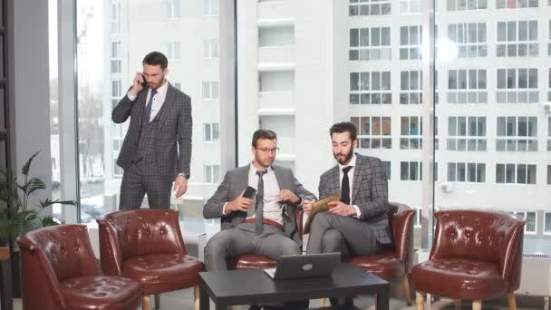Teamwork of business men in tux