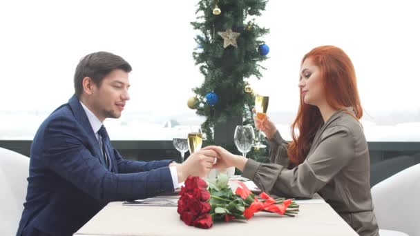 Romantic pastime of young beautiful caucasian couple in restaurant on a date.