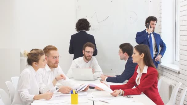 Young successful business people in office
