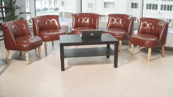 Empty cabinet for negotiations with leather chairs