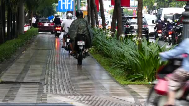 HO CHI MINH, VIETNAM - MARCH 18 2017: Unidentified people driving wrong way to footpath when traffic jam