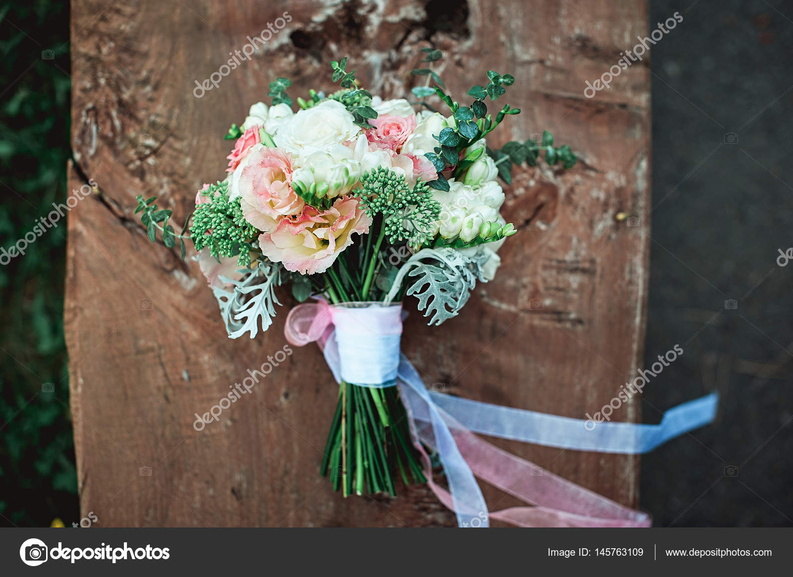Luxury bridal bouquet of white flowers on a wooden board stock luxury bridal bouquet of white flowers on a wooden board stock photo izmirmasajfo