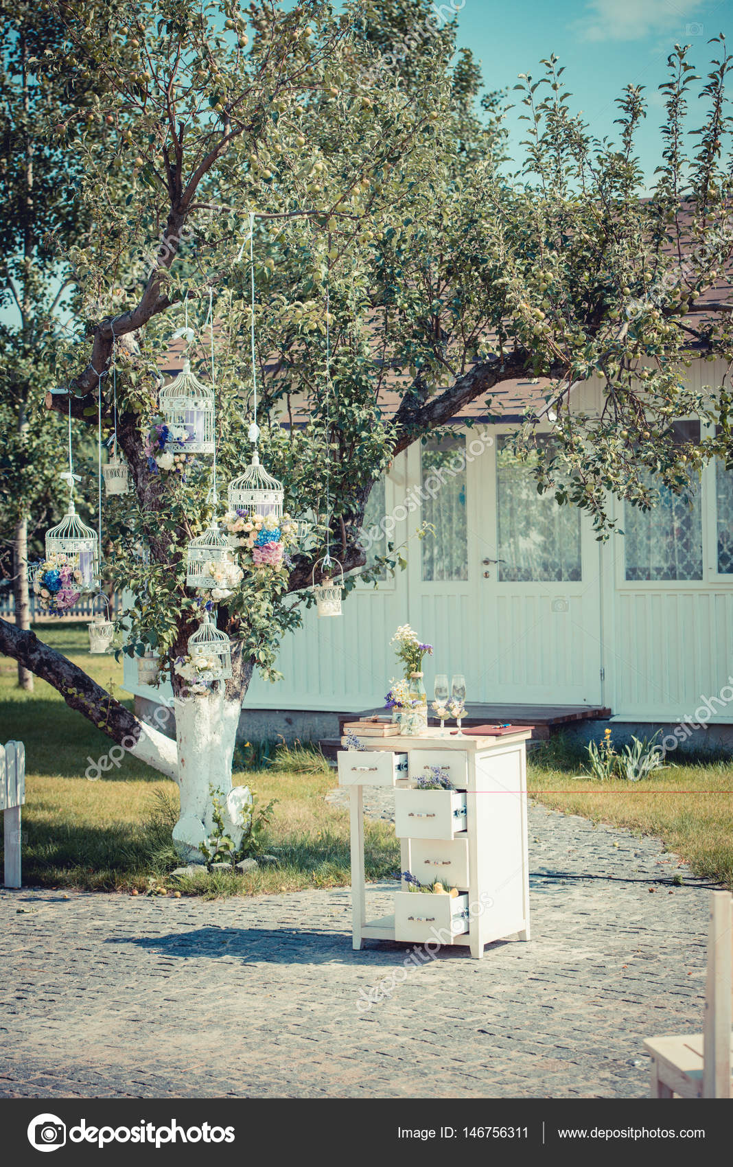 Beautiful Vintage Wedding Ceremony Outdoors Summertime Old White Wooden House Tree Decorated With Cages Full Of Flowers Rustic Style Table