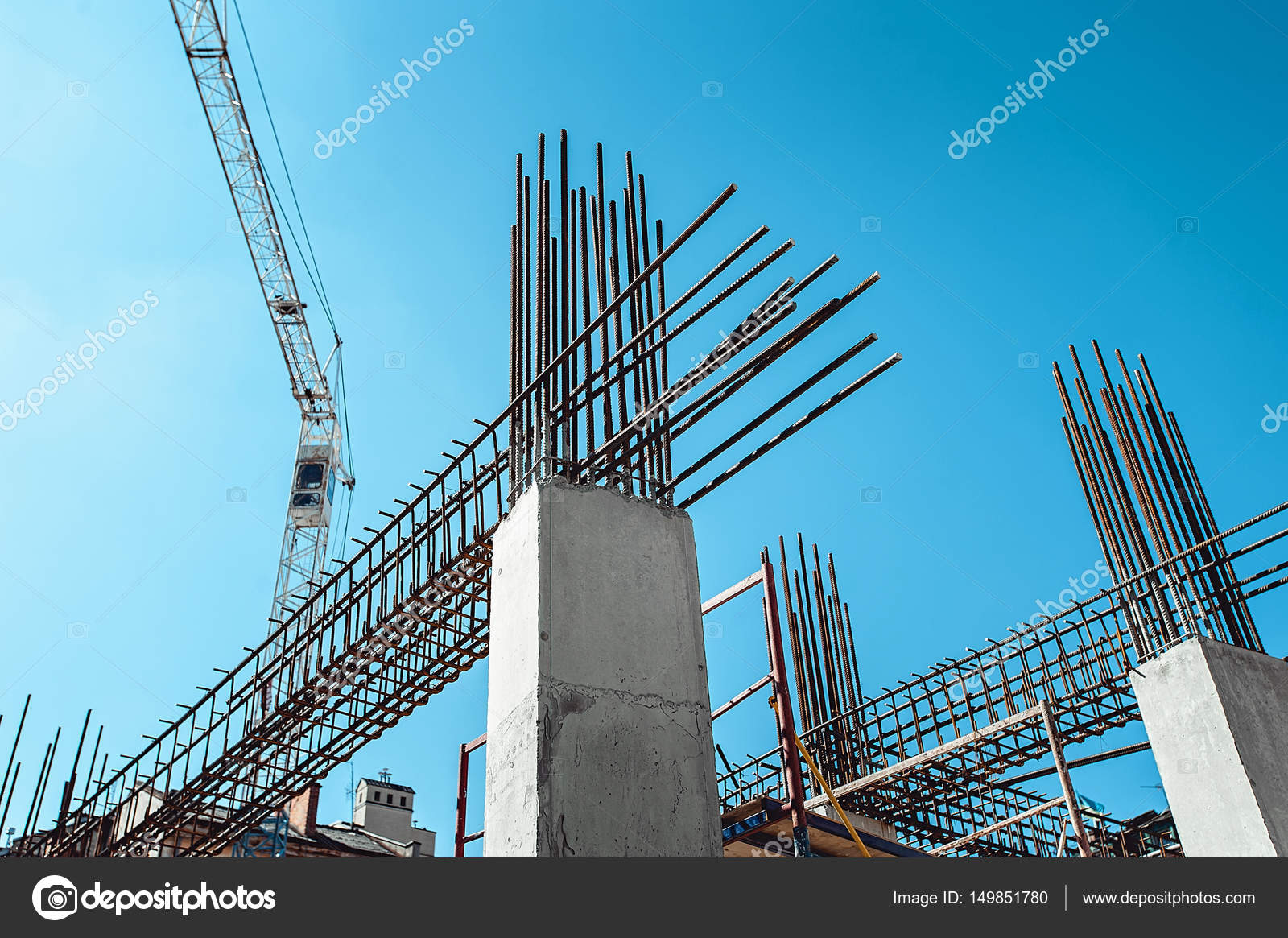 Steel Frames of A Building Under Construction, With Tower Crane On ...