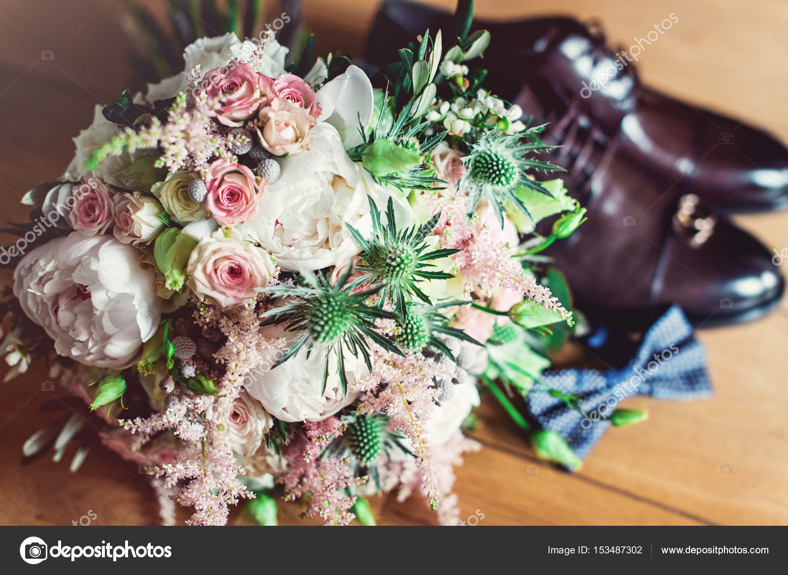 wedding bouquet on a background blue bow tie, leather shoes and ...