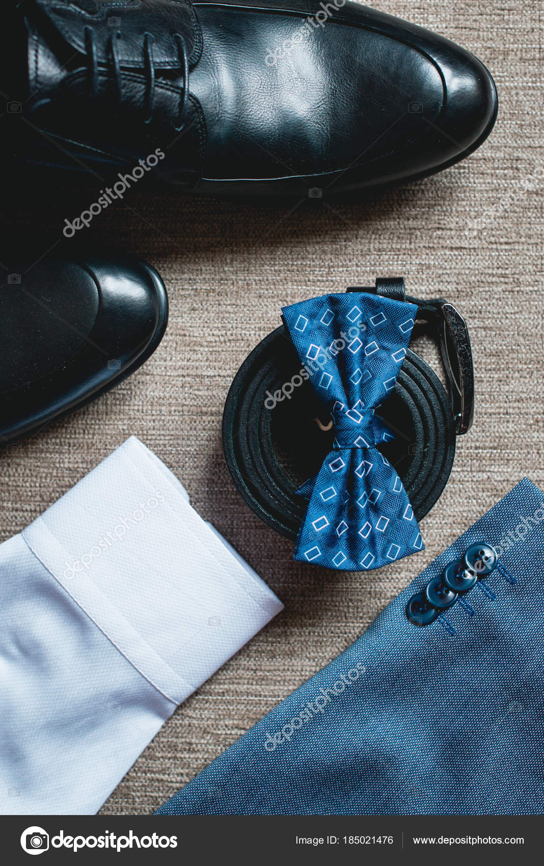 d4e28192c0c0 Suit, blue bow tie, leather black shoes and belt. Grooms wedding morning.  Close up of modern man accessories. Look from above — Photo by Ashtray25