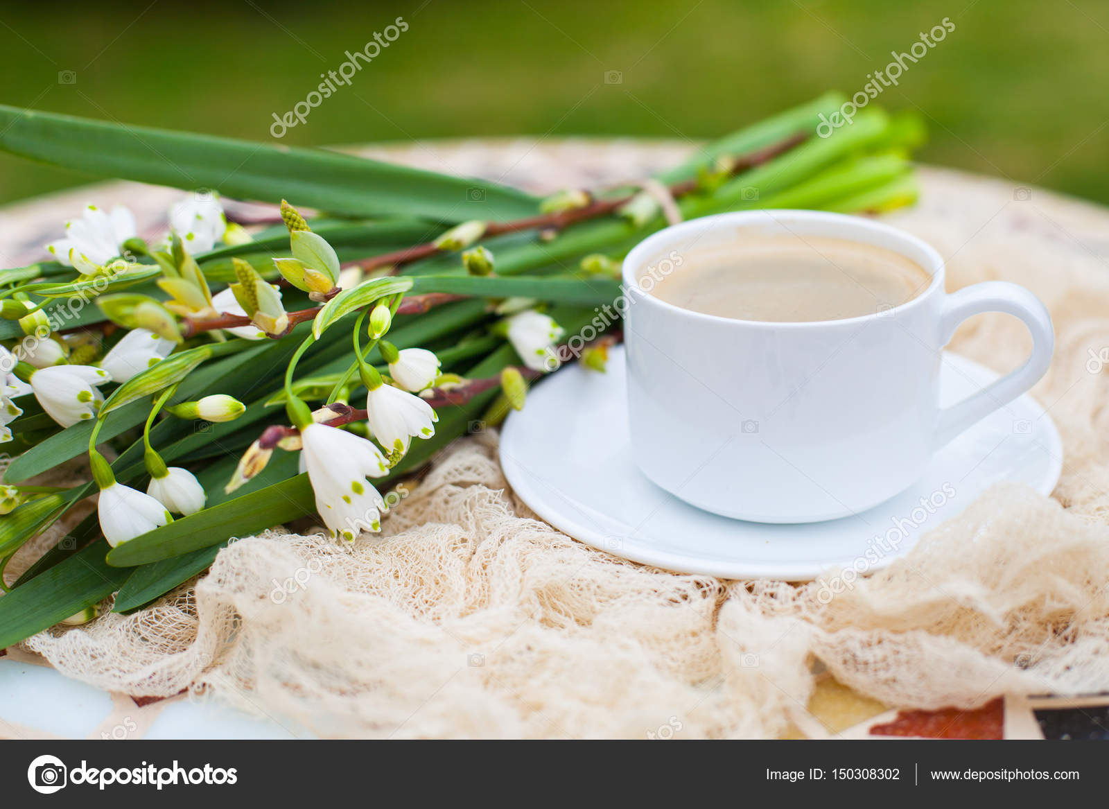 Bouquet White Spring Bell Flowers And Coffee Cup On Table In Gar