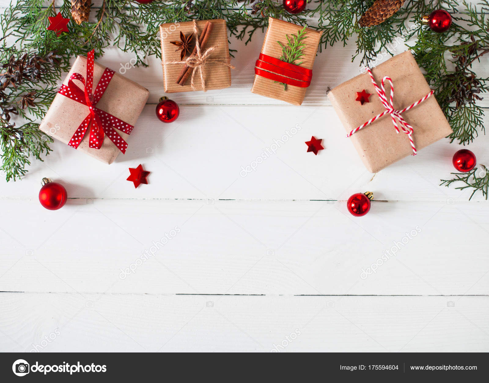 christmas or new year background plain composition made of xmas decorations gift and fir branches flat lay blank space for a greeting text photo by
