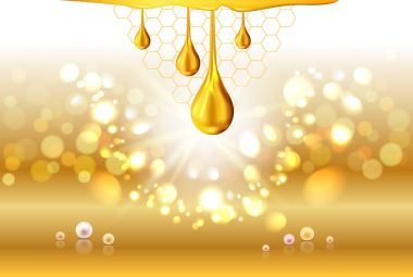 Golden oil drops shiny sparkles