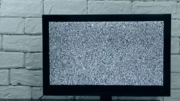 Analóg televíziós jelforrás glitching hatása. Hurok videó. Beltéri Tv modell akár.
