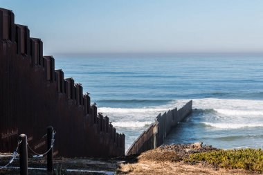 International Border Wall Extending Out Into The Pacific Ocean