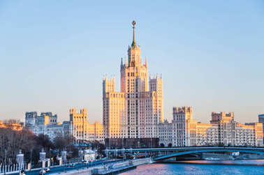 View on the Stalin skyscraper on the Kotelnicheskaya embankment of Moskva-river in the rays of the setting sun and. Winter cityscape